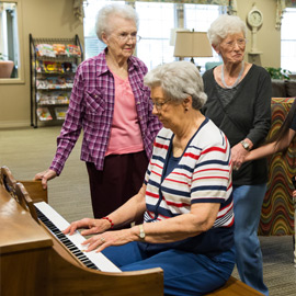 Residents enjoying piano music