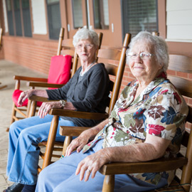 Friendly residents in porch rocking chairs