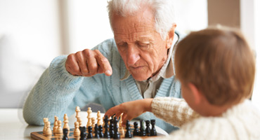 Nursing home residents playing chess